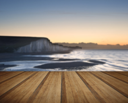 seven sisters: Seven Sisters chalk cliffs in England during Winter sunrise with wooden planks floor