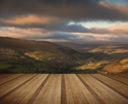 sulight: View along Swaledale in Yorkshire Dales National Park during Autumn sunrise with wooden planks floor