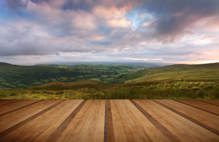 natural  moody: Beautiful landscape panorama across countryside to mountains with wooden planks floor