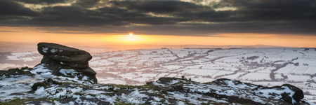 of pano: Stunning Winter panorama landscape snow covered countryside with beautiful sky and clouds
