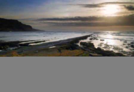 kimmeridge: Stunning landscape seascape coastline and rocky shore at sunset with wooden planks floor