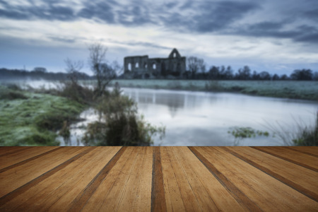 priory: Beautiful dawn landscape of Priory ruins in countryside location with wooden planks floor