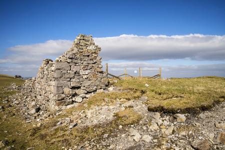 an agricultural district: Ruins of abandoned copper mines in landscape in Peak District in Uk
