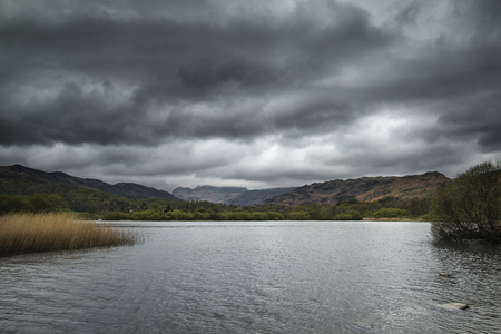 lake district england: Stormy dramatic sky over Lake District landscape in England