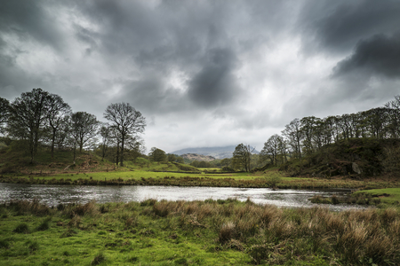 lake district: Stormy dramatic sky over Lake District landscape in England