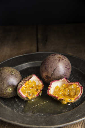 natural  moody: Passion fruit in moody natural light setting with vintage style