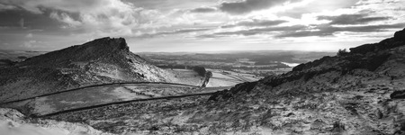 of pano: Stunning Winter panorama landscape snow covered countryside in black and white