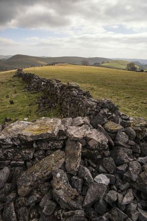 an agricultural district: Beautiful landscape of Peak District in UK with famous stone walls