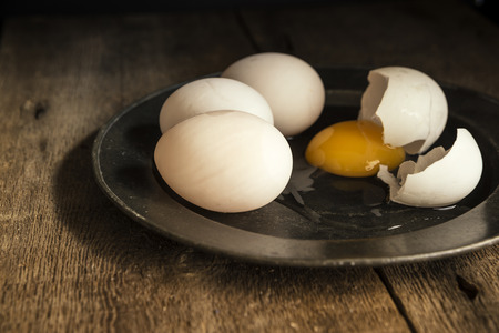 natural moody: Fresh duck eggs in moody vintage style natural lighting set up