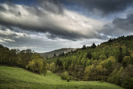 fells: Lake District landscape with stormy sky over countryside and fells Stock Photo