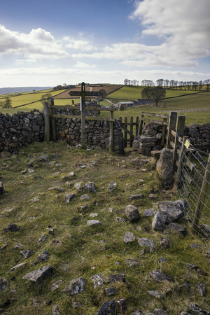 an agricultural district: Public footpath signposts in landscape in Peak District UK Stock Photo
