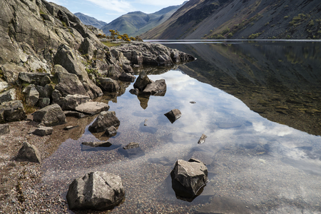 lake district: Stunning landscape of Wast Water with mountains reflected in calm lake water in Lake District