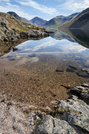 lake district: Stunning landscape of Wast Water and Lake District Peaks on Summer day reflected in perfect lake