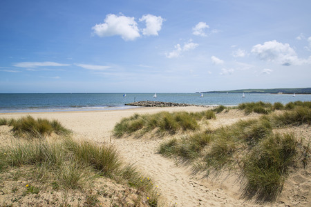 Beautiful sand dunes and beach landscape on sunny Summer day