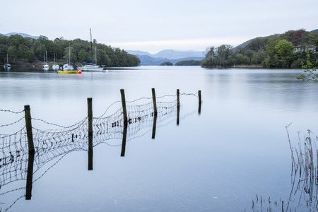 lake district: Calm moody evening landscape over Coniston Water in Lake District Stock Photo
