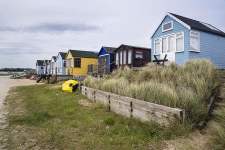 sand dunes: Beach huts on sand dunes and beach landscape
