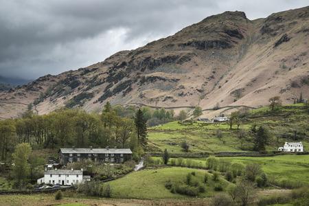 nestled: Beautiful old village landscape nestled amongst hills in Lake District