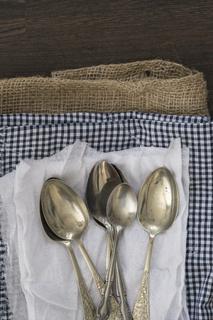 vintage cutlery: Vintage cutlery on cloths on wooden background Stock Photo