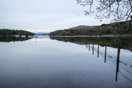 Calm moody evening landscape over Coniston Water in Lake District Stock Photo