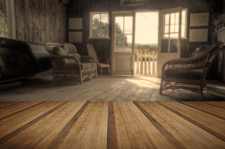 Retro style image of old boat house in bright Summer sun giving nostalgic feelings with wooden planks floor