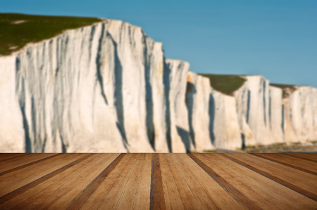 south downs: Landscape of Seven Sisters cliffs in South Downs National Park on English coast with wooden planks floor Stock Photo