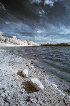 infrared: Infrared landscape of lake in English countryside in Summer with surreal colors