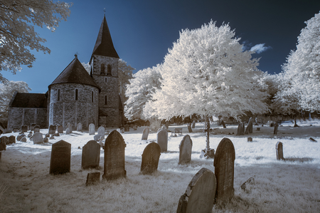 english countryside: Old church in English countryside landscape in infrared