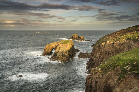 cornwall: Stunning sunrise landscape of Lands End in Cornwall England Stock Photo