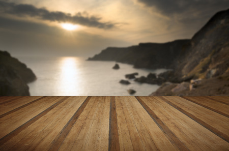 spring tide: Spring sunset at high tide at Kynance Cove with wooden planks floor