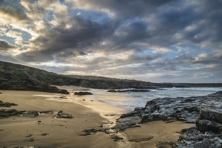pano: Stunning sunrise landscape of Godrevy on Cornwall coastline in England Stock Photo