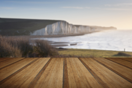 seven sisters: View from Seaford Head towards Seven Sisters at sunrise with wooden planks floor