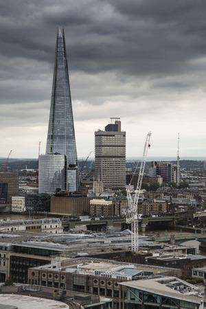 dramatic: London city aerial view over skyline with dramatic sky