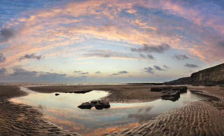 pano: Stunning panorama sunset landscape over Dunraven Bay in Wales
