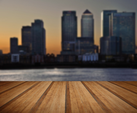 river thames: View of London City skyline at night on clear sky with reflections in River Thames with wooden planks floor