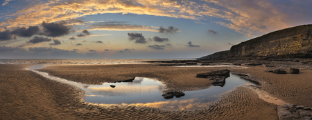 of pano: Stunning panorama sunset landscape over Dunraven Bay in Wales