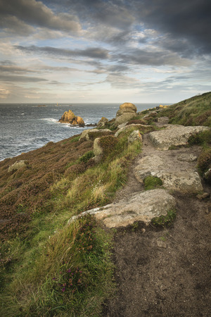 cornwall: Beautiful sunrise landscape image of Lands End in Cornwall England