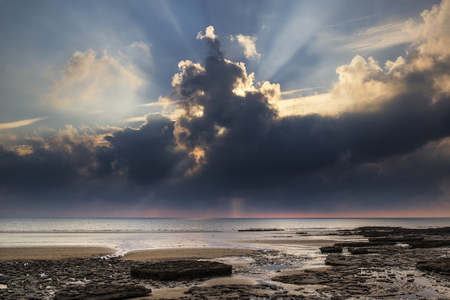 pano: Stunning sunset landscape over Dunraven Bay in Wales Stock Photo