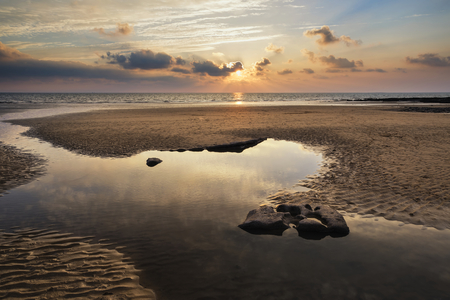 Stunning sunset landscape over Dunraven Bay in Wales Stock Photo