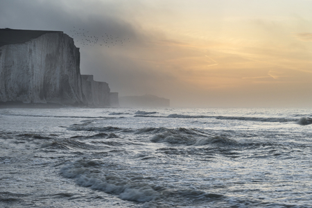 seven sisters: Stunning foggy Winter sunrise Seven Sisters cliffs landscape in England Stock Photo