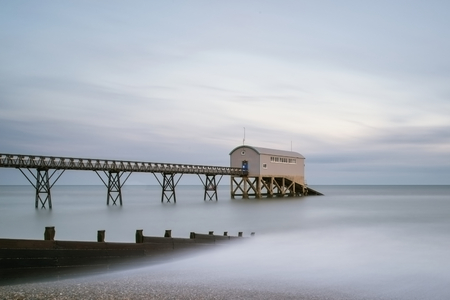 long exposure: Beautiful long exposure landscape image of lifeboat jetty at sea