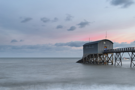 lifeboat station: Beautiful long exposure landscape image of lifeboat jetty at sea