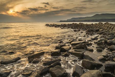 Stunning sunset landscape image of rocky coastline in Dorset England