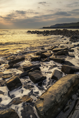 dorset: Stunning sunset landscape image of rocky coastline in Dorset England