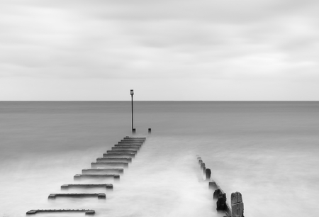 Long exposure landscape image of sea and groynes