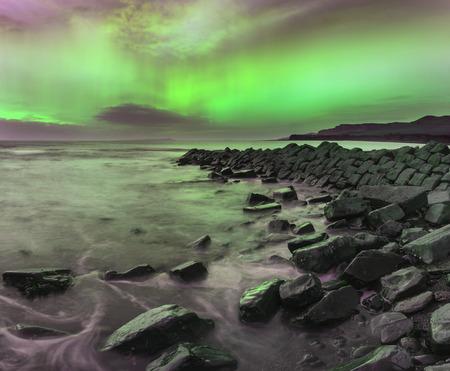northern lights: Stunning Northern Lights Aurora Borealis over coastal landscape