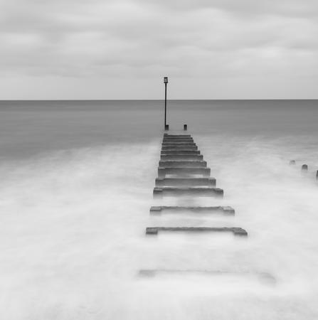 groynes: Long exposure landscape image of sea and groynes Stock Photo