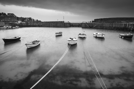 old english: Black and white image of traditional English old fishing village