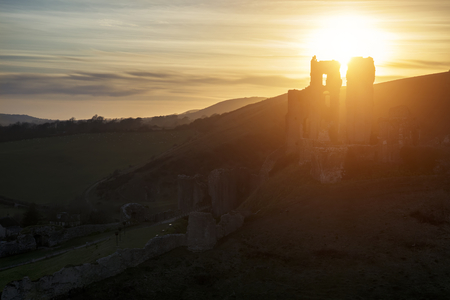enchanting: Landscape image of enchanting fairytale castle ruins during beautiful sunset