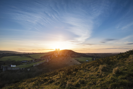 fairytale castle: Landscape image of enchanting fairytale castle ruins during beautiful sunset