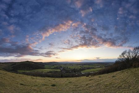 sunlgiht: Stunning landscape image of sunset over countryside landscape in England